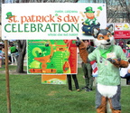 Axio with the St. Patrick's Day Celebration sign
