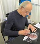 Christopher Lloyd, signing a picture for Ultra-Gor