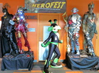 Tech-E also poses between the Herofest statues