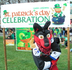 Dakota with the St. Patrick's Day Celebration sign