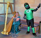 Green Lantern enjoys the heavenly harp music in the library at the festival!