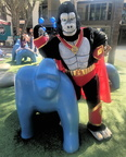 Two gorillas posing, one blue, one red, gold & black!